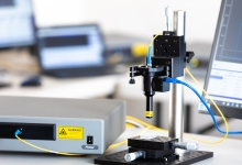 Non-contact thickness gauge range extended